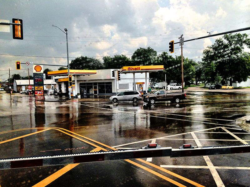 T shell station rain out my train window